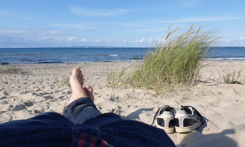 Sitting on the beach to show how relaxing Denmark can be