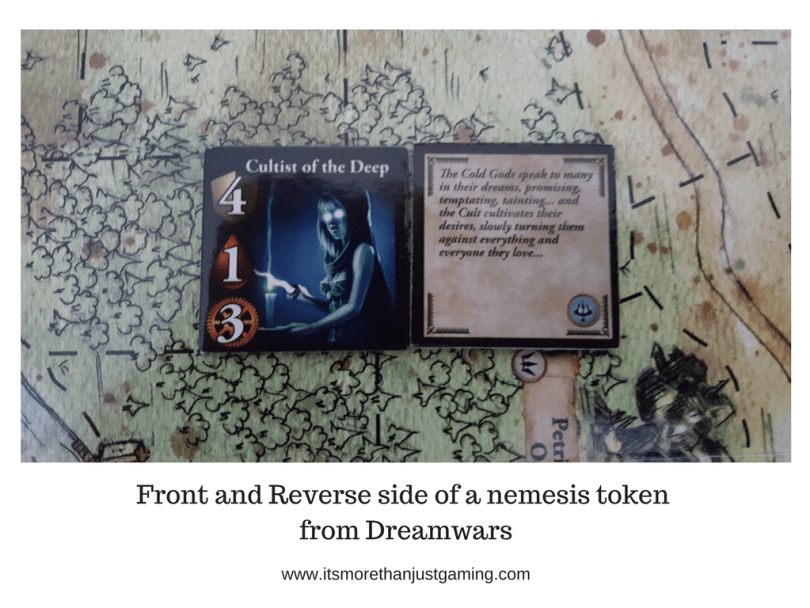Front and Reverse side of a nemesis token from Dreamwars