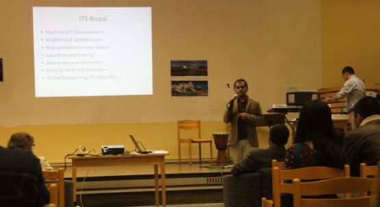 Coordinator of E-education project giving presentation on Nepalese Cultural Evening