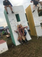 In front of the Creamfields sign