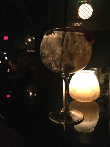 Gin and tonic — with an edible flower garnish.