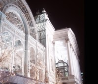 ROYAL OPERA HOUSE REDEVELOPMENT (1999)Pictured: Floodlit night view of part of the Bow Street elevation showing the rebuilt Floral Hall and the restored Royal Opera House..Photograph by Rob Moore.