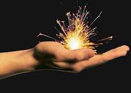hand holding spark