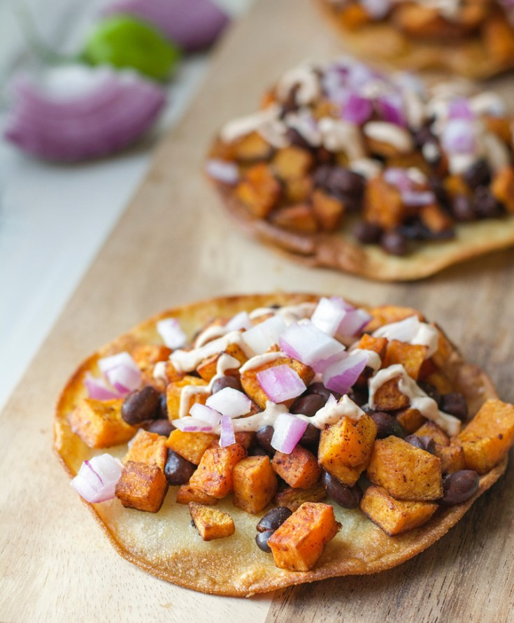 These vegetarian Sweet Potato Black Bean Tostadas with Chipotle Cream are full of flavor, protein, and fiber! Everyone will enjoy this healthy dinner!