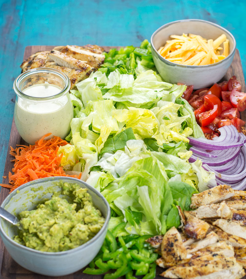 This Chicken Taco Salad Board is put together with fresh ingredients for everyone to enjoy! Bring everyone together this Taco Tuesday with a beautiful entertaining board.