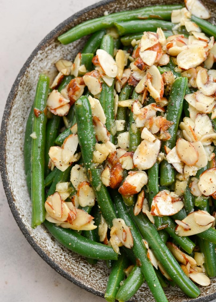 Garlic Butter Green Beans are a family favorite! Tender green beans are tossed in a rich butter sauce and topped toasted almonds, each serving is just under 4 net carbs.