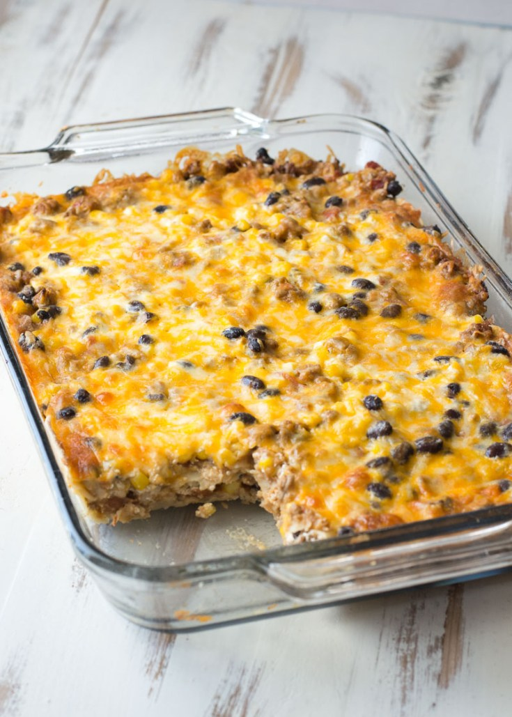 Layered Taco Casserole is a kid-friendly, gluten free casserole that is loaded with taco meat, beans and cheese!