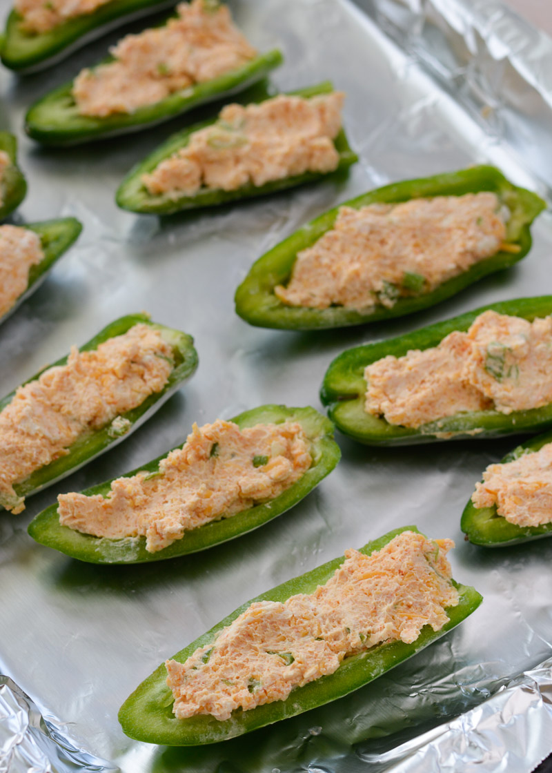 These Keto Jalapeno Poppers are loaded with two kinds of cheese and wrapped in pepper bacon! This easy low carb appetizer can be made in the oven, on the grill or in the air fryer!