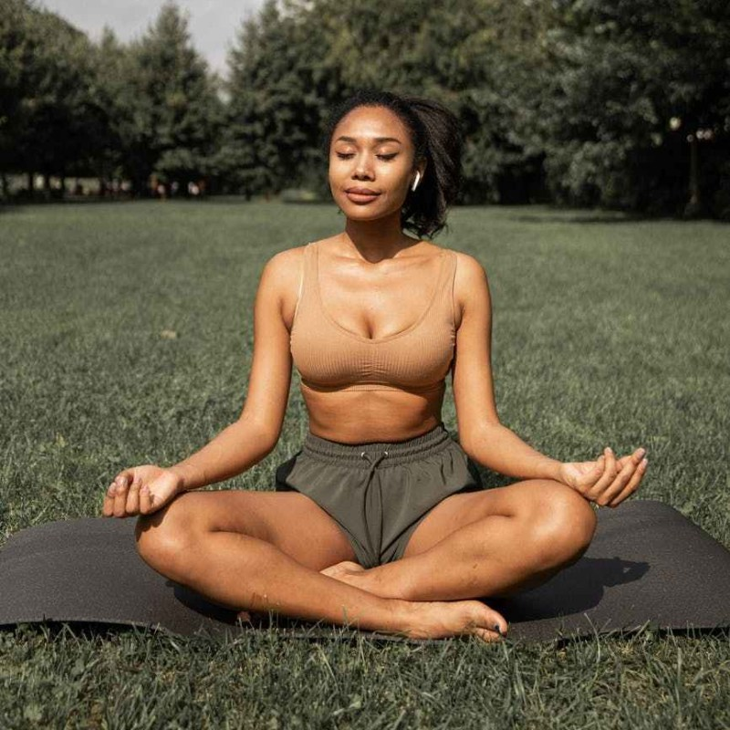 flexible woman practicing yoga in nature