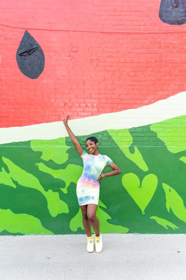 woman wearing multicolored dress celebrating ivn turns 3