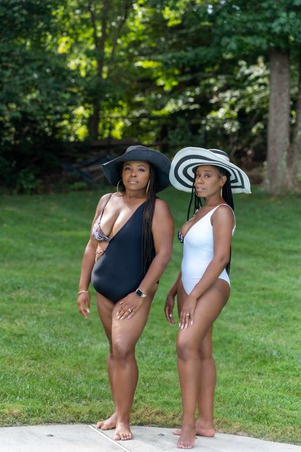 two women wearing the matte collection swimsuit and hats