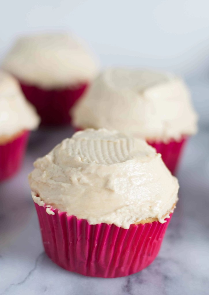 photo of banana cupcakes frosted with peanut butter frosting before they've been decorated