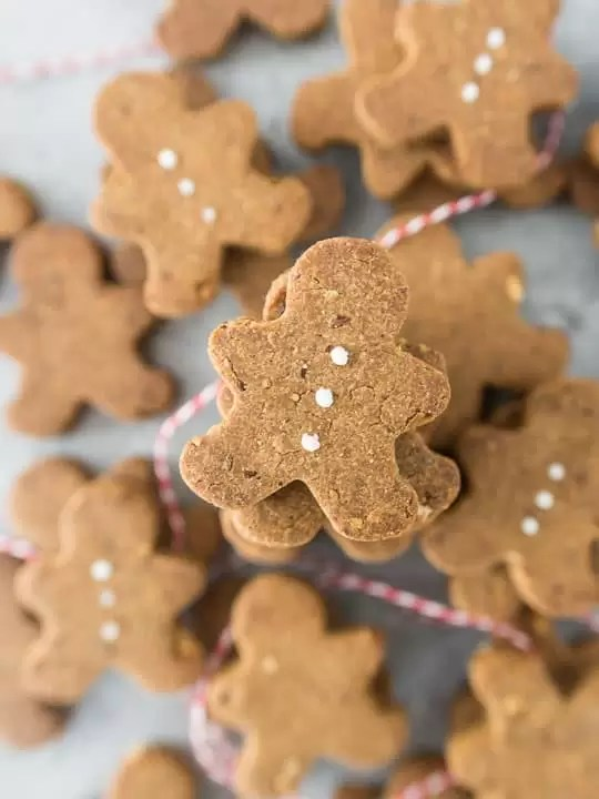 overhead photo of stacked gluten-free dog treats decorated with cream cheese 'buttons'