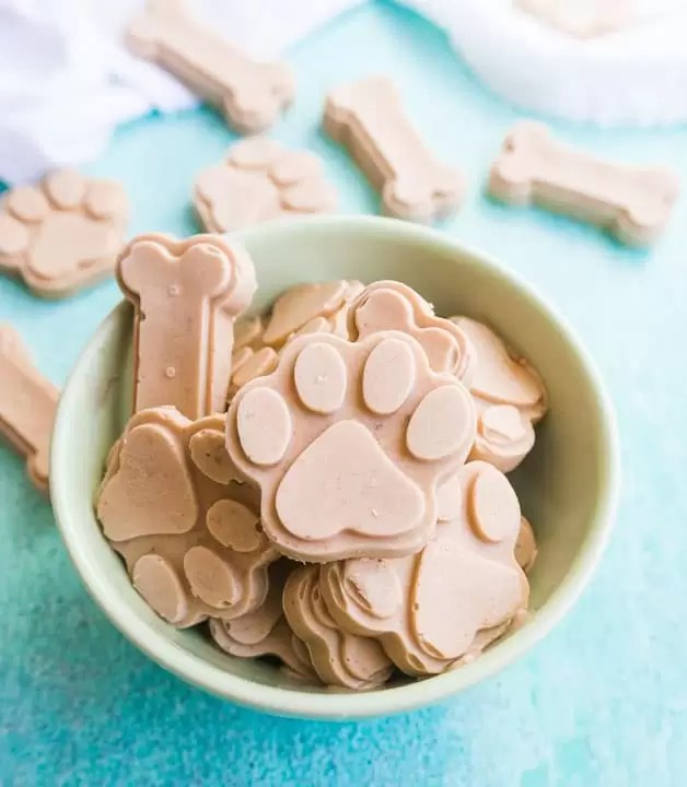 overhead shot of peanut butter banana ice cream for dogs in a green bowl
