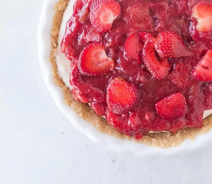 overhead shot of strawberry rhubarb cheesecake pie
