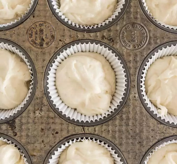 overhead shot of unbaked white chocolate cupcakes in the pan