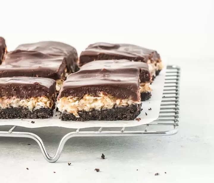 sliced chocolate coconut bars on a wire rack