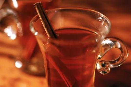 Mulled cider with cinnamon stick