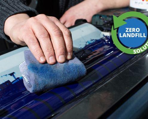 Printer towel wiping solvent at a printing facility