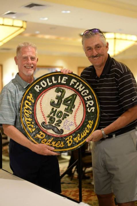 Featured celebrity Rollie Fingers poses with Phil Navertil who bid on a custom, hand carved plaque made for the event.