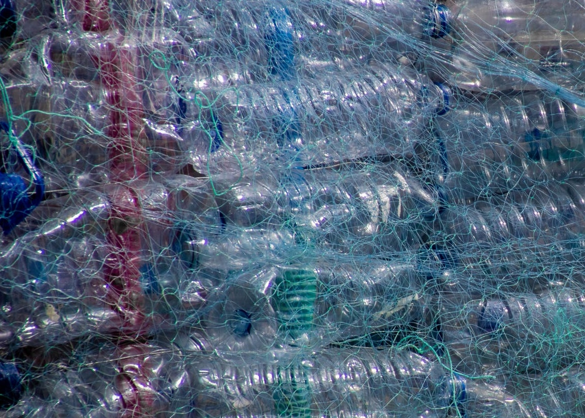 netting full of plastic water bottles pollution
