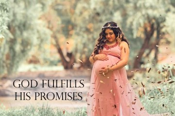 """God fulfills his promises."" Pregnant woman standing in a field, smiling at her belly."