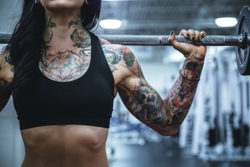 Female weight lifter by Alora Griffiths via Unsplash