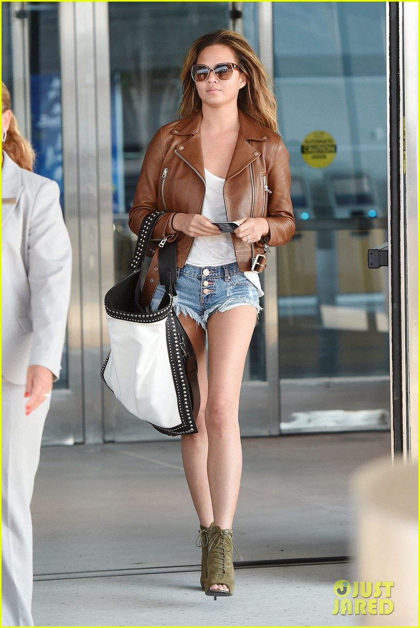 **USA ONLY** *EXCLUSIVE* New York, NY - Chrissy Teigen struts her stuff through JFK Airport in New York. The SI Swimsuit model showcased her long legs in a pair of very short cut-offs with a white t-shirt, leather jacket jacket and a pair of peep toed lace up heels.  AKM-GSI           August 16, 2015 **USA ONLY** To License These Photos, Please Contact :    Steve Ginsburg  (310) 505-8447  (323) 423-9397  steve@akmgsi.com  sales@akmgsi.com    or    Maria Buda  (917) 242-1505  mbuda@akmgsi.com  ginsburgspalyinc@gmail.com