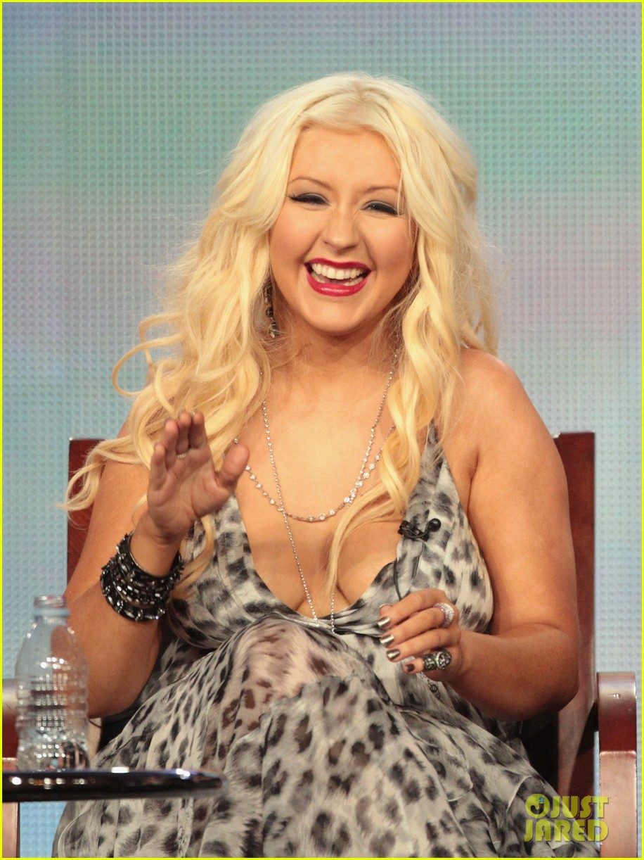 "PASADENA, CA - JANUARY 06:  Coach Christina Aguilera speaks onstage during the ""The Voice"" panel during the NBCUniversal portion of the 2012 Winter TCA Tour at The Langham Huntington Hotel and Spa on January 6, 2012 in Pasadena, California.  (Photo by Frederick M. Brown/Getty Images)"