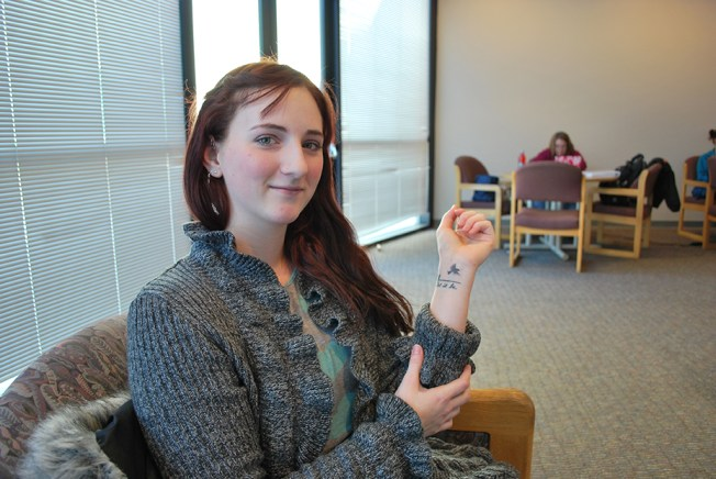 Michell Howell shows off one of her tattoos. For her senior project, she's interviewing tattoo artists in the region. Preface/NICK WORT