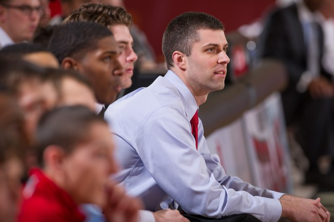 Scott Cooper watches from the sideline during his inaugural season with the men's basketball team. (Photo Provided by Scott Cooper)