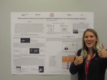 Haley Borsodi posing for the camara infront of her Dark Matter project
