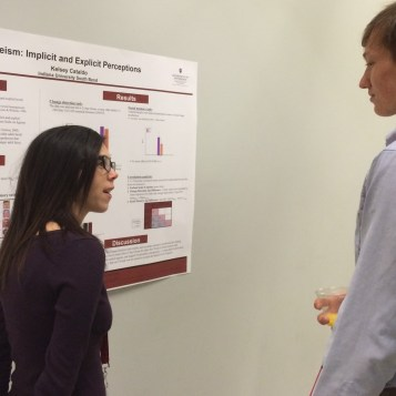 Kelsey Cataldo, left, presents her work on exploring the implicit and explicit perceptions of ageism Friday, April 17, 2015. (Photo/Bri Schmitt).