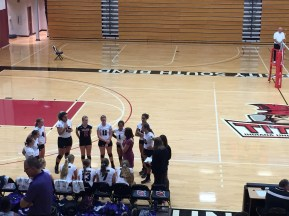 Coach Ashmore circles up with her team as they begin the second set against ONU