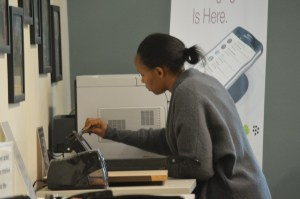Student, Rose Wamburu, uses a printer in the library. PHOTO/C.A. Printup