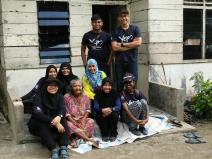 Group from NUSMS with the recipient of the toilet facility.