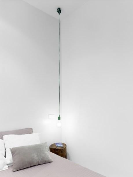 Iluminación mesita de noche. Diseño interior de mini-apartamento en Madrid