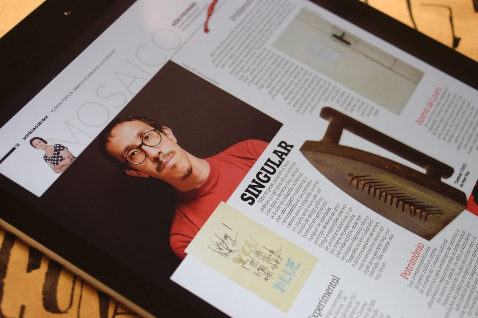Página do jornal com foto do autor, acompanhado de trabalho de caligrafia