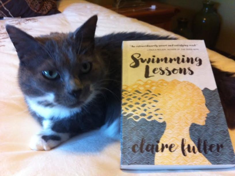 Anne Logan's adorable cat sitting by Claire Fuller's 'Swimming Lessons'