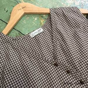 Arthur Hill Frock in Brownstone Banister Checked Cotton with antique wooden buttons by Ivey Abitz