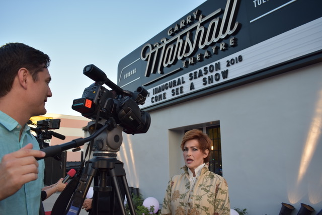 Carolyn Hennesy talking to the press at the Garry Marshall Theatre wearing Ivey Abitz Fall Bespoke.