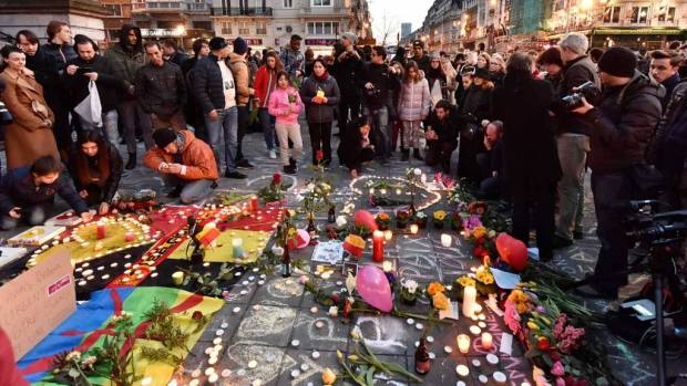 People bring flowers and candles to mourn at Place de la Bourse in the center of Brussels, Tuesday, March 22, 2016. Bombs exploded at the Brussels airport and one of the city's metro stations Tuesday, killing and wounding scores of people, as a European capital was again locked down amid heightened security threats. (AP Photo/Martin Meissner) Belgium Attacks