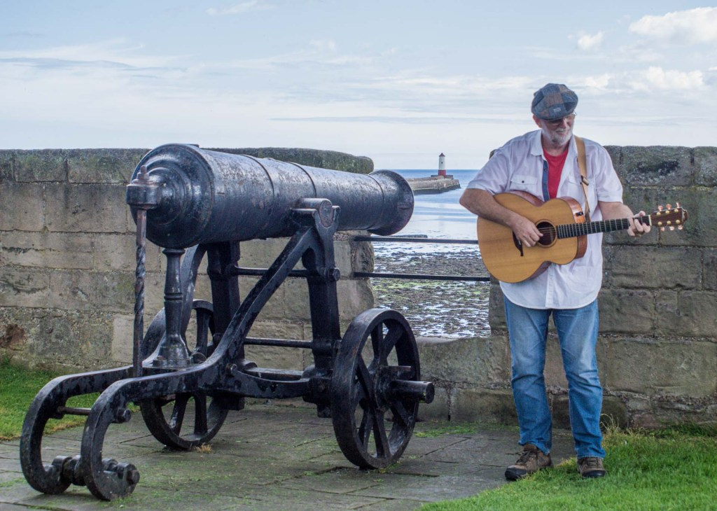 Singer standing next to a Canon.