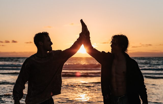 Picture of two men high-fiving