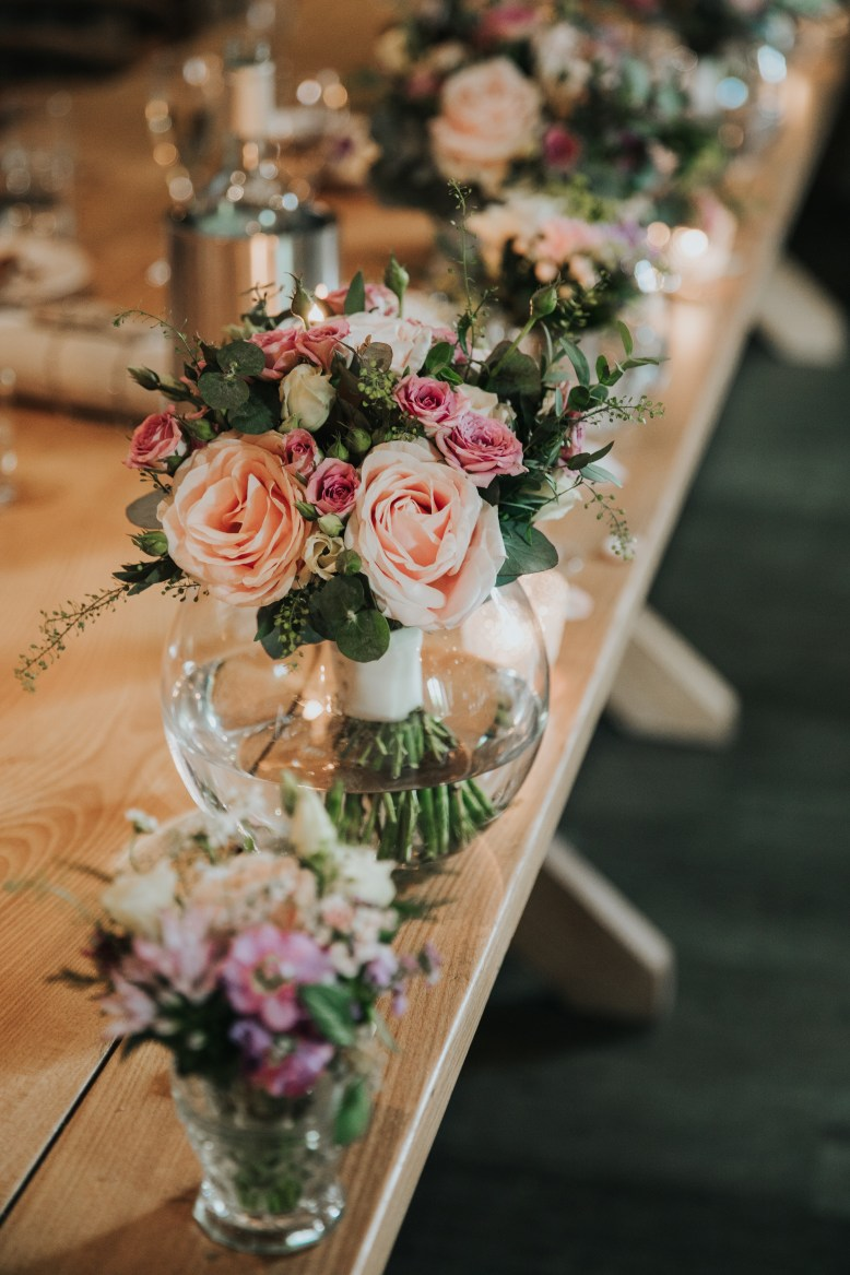 Wedding florals for a top table.