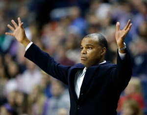 Tommy Amaker holds up one finger for every field goal the Crimson made at UVA ... except he