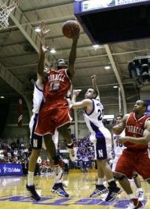 Louis Dale drives for a layup in his first collegiate game, a 64-61 win over Northwestern.