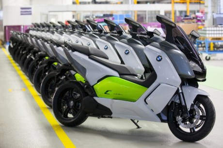 BMW C Evolution electric scooters manufactured by BMW Motorrad, a unit of Bayerische Motoren Werke AG, stand on display during an event to mark the start of production at the plant in Berlin, Germany, on Friday, April 4, 2014. German factory orders rose in February, adding to signs that growth in Europe's largest economy is gathering pace. Photographer: Krisztian Bocsi/Bloomberg via Getty Images