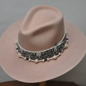 pink hat with skull and crossbones hatband and beaded pearl hatband