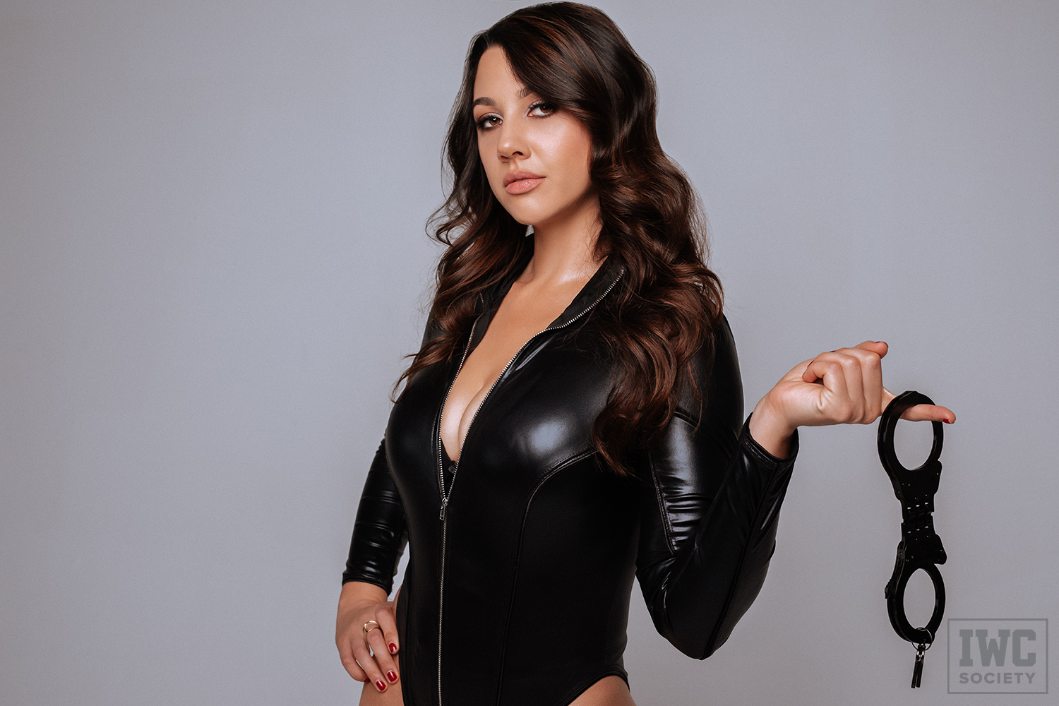 financial dominatrix Ceara Lynch holding black handcuffs